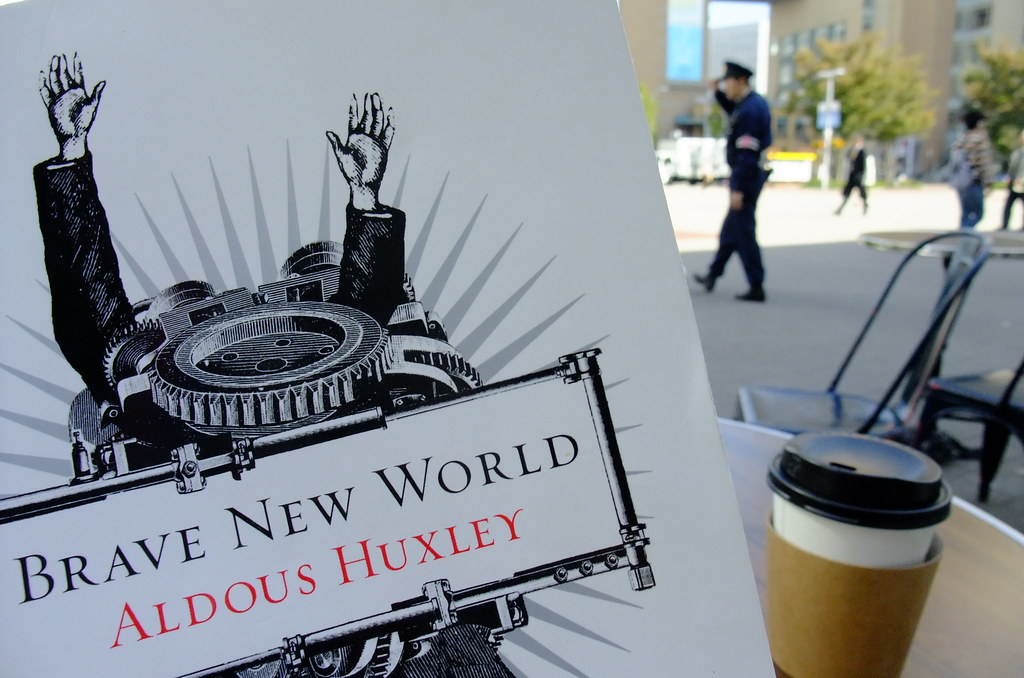 cover of the book Brave New World with cup of coffee in the background